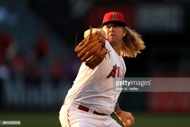 John Lamb of the Los Angeles Angels of Anaheim pitches during the first inning of a game against the Toronto Blue Jays at Angel Stadium on June 21...