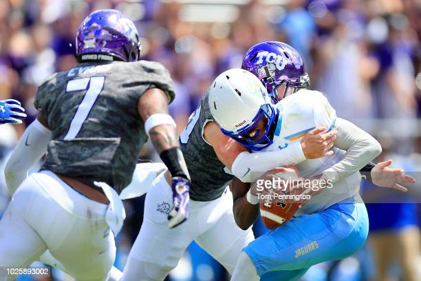 John Lampley of the Southern University Jaguars is sacked by Garret Wallow of the TCU Horned Frogs and Arico Evans of the TCU Horned Frogs in the...