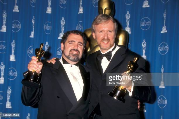 John Landau and James Cameron at the 70th Annual Academy Awards, Shrine Auditorium, Los Angeles.
