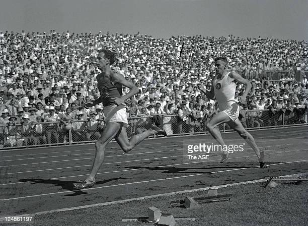 John Landy leads Merv Lincoln in the third lap of the mile race where he managed a time below the four minutes at Olympic Park in Melbourne