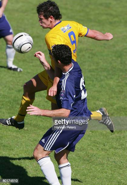 John Lang of Otago heads the ball away from Riki van Steeden of Auckland City during the round 17 New Zealand Football Championship match between...