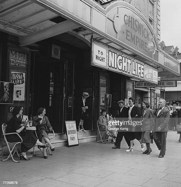 John Langridge and his wife arrive at the Chiswick Empire with their friends Matilda Ball and Bert Osborne, for a showing of 'Night Life', 17th July...