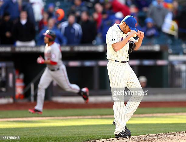 John Lannan of the New York Mets reacts as Anthony Rendon of the Washington Nationals rounds third in the 10th inning during Opening Day on March 31...