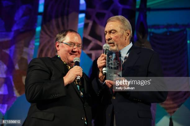 John Lasseter receives the Diane Disney Miller Lifetime Achievement Award from Ron Miller President of the Board of The Walt Disney Family Museum...