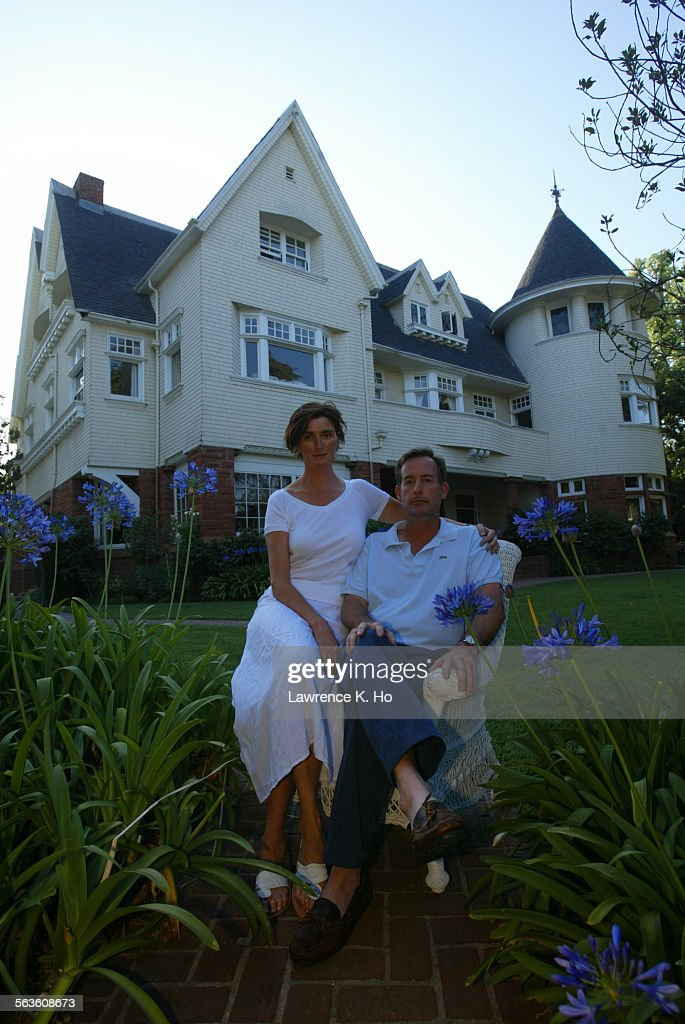 John Laviolette with wife Lucy Dahl in front of their house in Windsor Square. They are for the HPOZ : News Photo