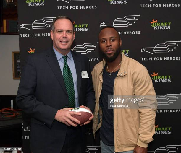 John Lawn and James White atend DraftKings Hosts Veterans Appreciation Event at MJ O'Connors on November 8 2018 in Boston Massachusett