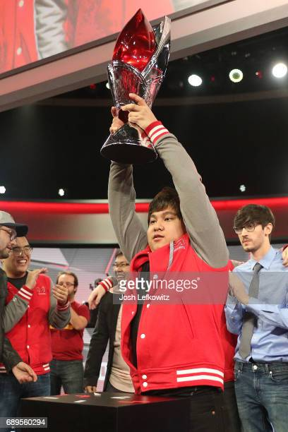 John Le holds the championship trophy at the League of Legends College Championship between Maryville University and the University of Toronto at the...