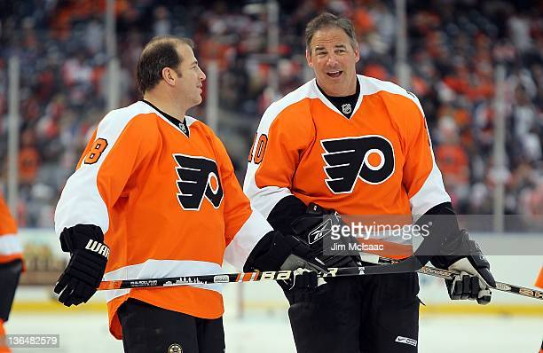 John Leclair and Mark Recchi of the Philadelphia Flyers warms up before playing against the New York Rangers during the 2012 Bridgestone NHL Winter...
