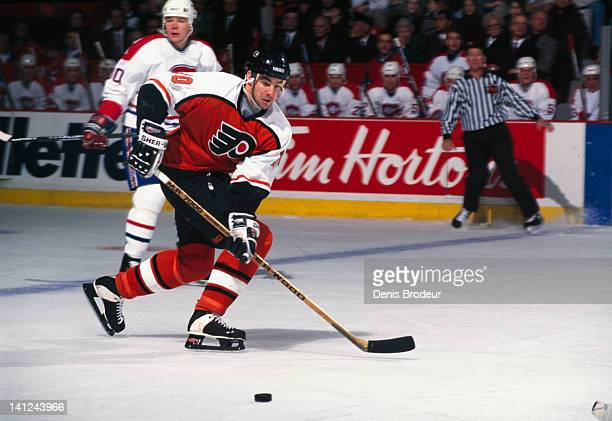 John Leclair of the Philadelphia Flyers receives a pass from a teammate Circa 1990 at the Montreal Forum in Montreal Quebec Canada