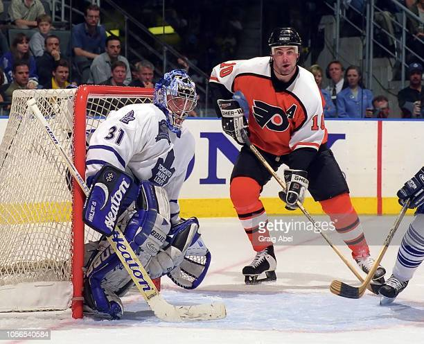 John LeClair of the Philadelphia Flyers skates against Curtis Joseph of the Toronto Maple Leafs during the 1999 NHL SemiFinal playoff game action at...