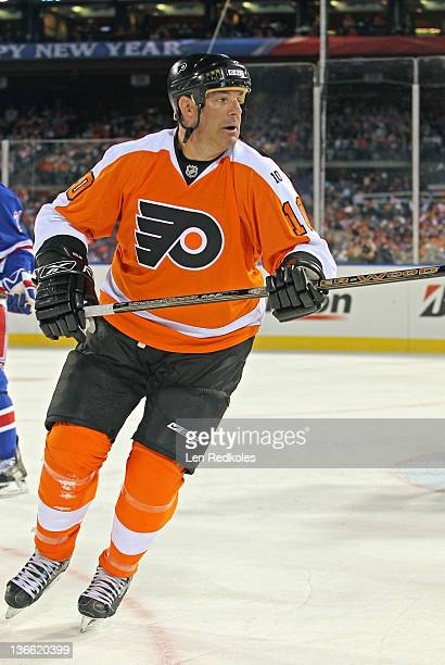 John LeClair of the Philadelphia Flyers skates against the New York Rangers during the Alumni Game prior to the 2012 NHL Bridgestone Winter Classic...