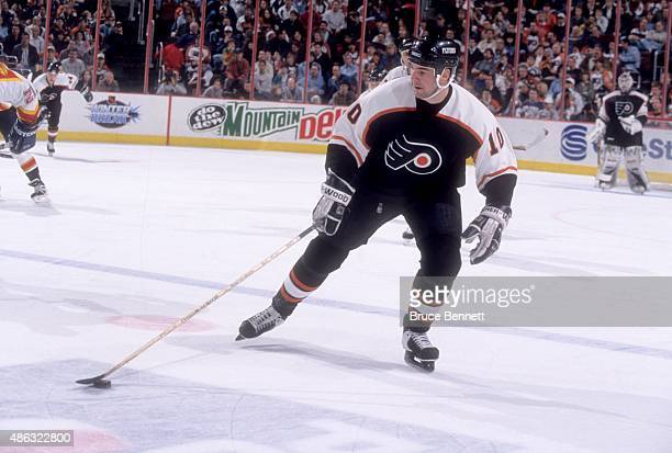 John LeClair of the Philadelphia Flyers skates on the ice during an NHL game against the Florida Panthers on December 20 1997 at the Wells Fargo...