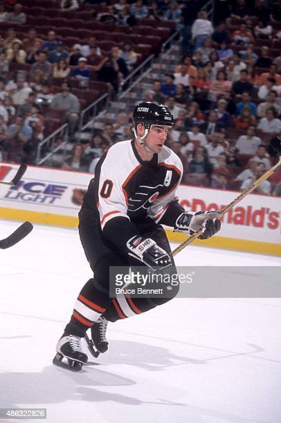 John LeClair of the Philadelphia Flyers skates on the ice during an NHL game in March 1998 at the Wells Fargo Center in Philadelphia Pennsylvania