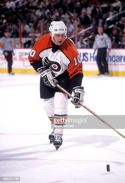 John LeClair of the Philadelphia Flyers skates with the puck during an NHL preseason game in September 1997 at the Wells Fargo Center in Philadelphia...