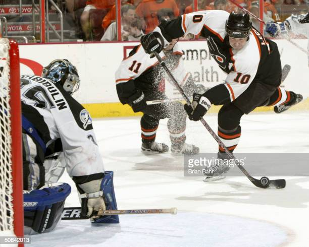 John LeClair of the Philadelphia Flyers takes a shot against goalie Nikolai Khabibulin of the Tampa Bay Lightning in Game four of the 2004 NHL...