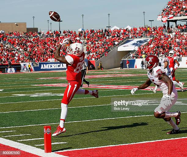 John Leday of the Houston Cougars as the ball go off is fingertips as Nate Hairston of the Temple Owls defends at TDECU Stadium on December 5 2015 in...