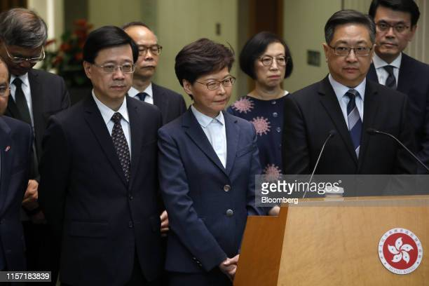 John Lee Hong Kong's secretary for security from left Carrie Lam chief executive center and Stephen Lo police commissioner attend a news conference...