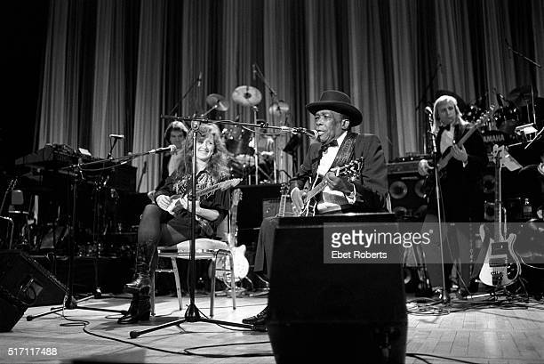 John Lee Hooker and Bonnie Raitt at the Rock N' Roll Induction Ceremony at the Waldorf Astoria Hotel in New York City on January 16 1991