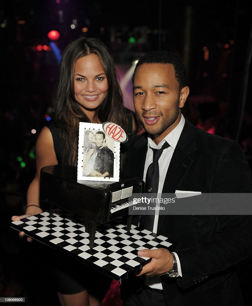 John Legend (R) and and model Chrissy Teigen (L) celebrate John Legend's birthday at Haze Nightclub in Aria at CityCenter on January 15, 2011 in Las Vegas, Nevada.