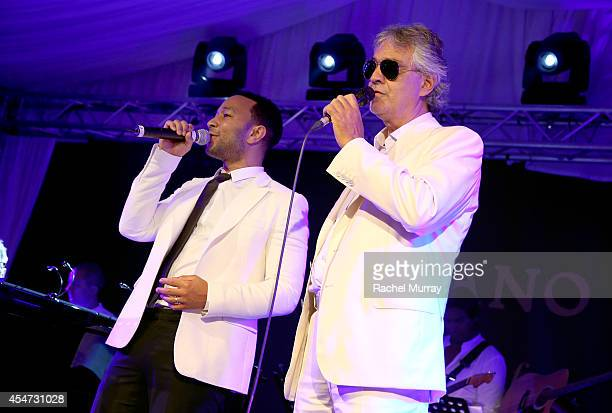 John Legend and Andrea Bocelli perform onstage during the white party dinner hosted by Andrea and Veronica Bocelli celebrating Fight Night In Italy...