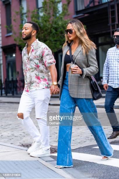 John Legend and Chrissy Teigen are seen in SoHo on August 19, 2021 in New York City.