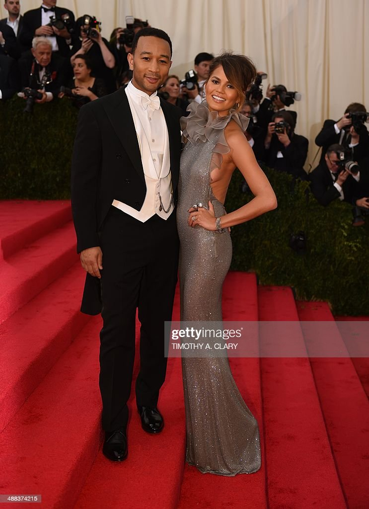 John Legend (L) and Chrissy Teigen arrive at the Costume Institute Benefit at The Metropolitan Museum of Art May 5, 2014 in New York. AFP PHOTO/Timothy A. CLARY