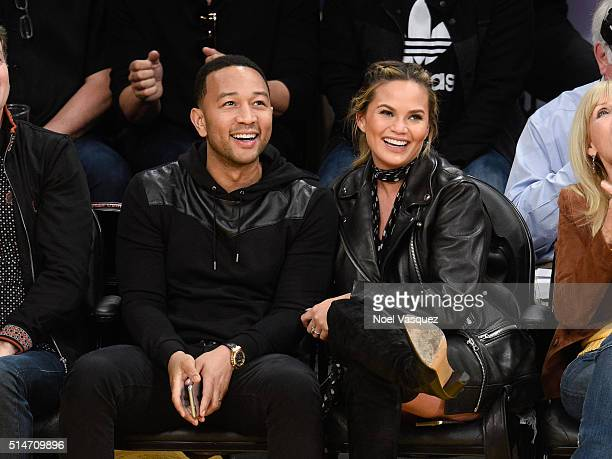 John Legend and Chrissy Teigen attend a basketball game between the Cleveland Cavaliers and the Los Angeles Lakers at Staples Center on March 10 2016...
