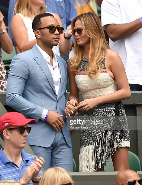 John Legend and Chrissy Teigen attend day seven of the Wimbledon Tennis Championships at Wimbledon on July 6 2015 in London England