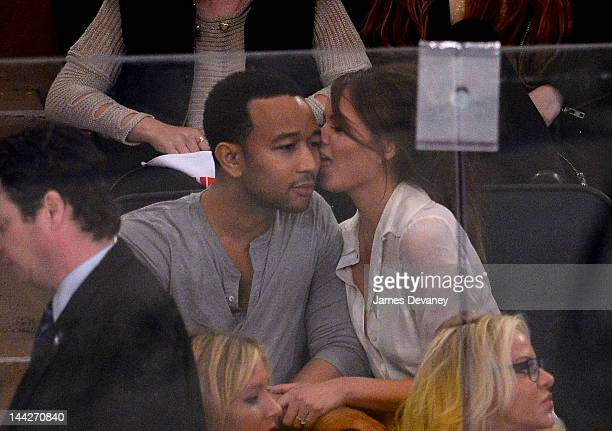 John Legend and Chrissy Teigen attend New York Rangers versus Washington Capitals playoff game at Madison Square Garden on May 12 2012 in New York...
