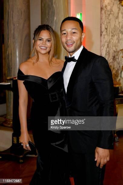 John Legend and Chrissy Teigen attend Pianists Lang Lang & Gina Alice Cocktail Wedding at Hotel Shangri-La on June 02, 2019 in Paris, France.