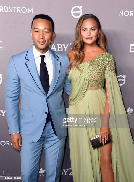 John Legend and Chrissy Teigen attend the 2019 Baby2Baby Gala presented by Paul Mitchell at 3LABS on November 09 2019 in Culver City California