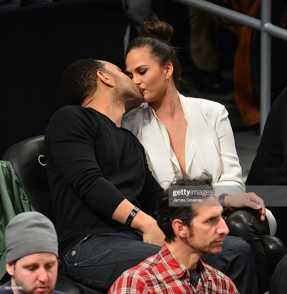 John Legend and Chrissy Teigen attend the Los Angeles Lakers vs Brooklyn Nets game at Barclays Center on February 5, 2013 in the Brooklyn borough of New York City.
