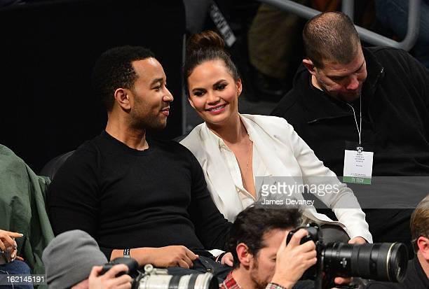 John Legend and Chrissy Teigen attend the Los Angeles Lakers vs Brooklyn Nets game at Barclays Center on February 5 2013 in the Brooklyn borough of...