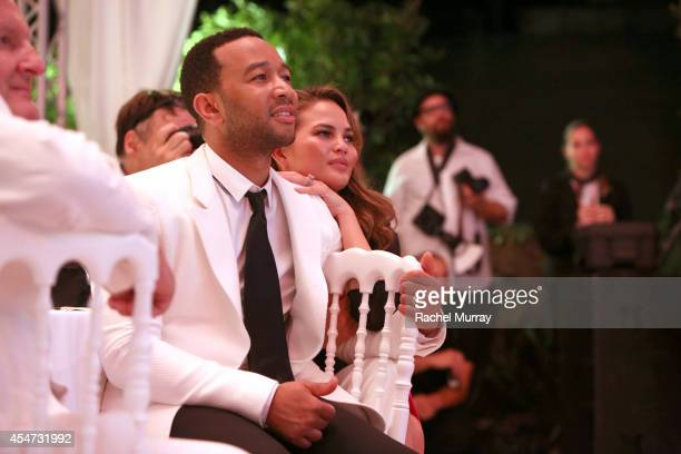John Legend and Chrissy Teigen attend the white party dinner hosted by Andrea and Veronica Bocelli celebrating Fight Night In Italy benefitting The...