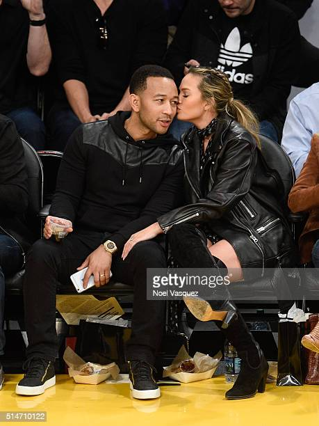 John Legend and Chrissy Teigen kiss at a basketball game between the Cleveland Cavaliers and the Los Angeles Lakers at Staples Center on March 10...