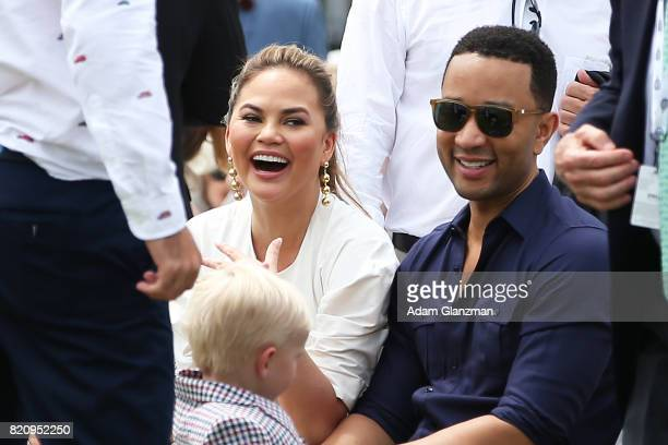 John Legend and Chrissy Teigen look on during the Tennis Hall of Fame induction ceremonies at the International Tennis Hall of Fame on July 22 2017...