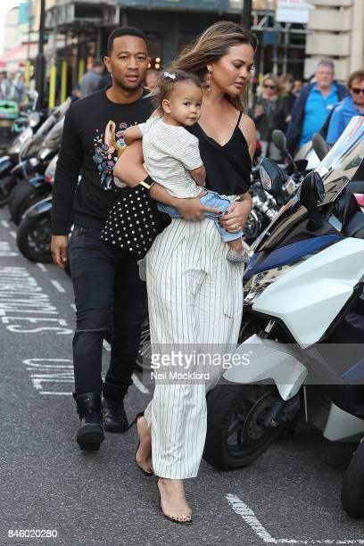 John Legend and Chrissy Teigen with their daughter Luna seen heading out to lunch on September 12 2017 in London England