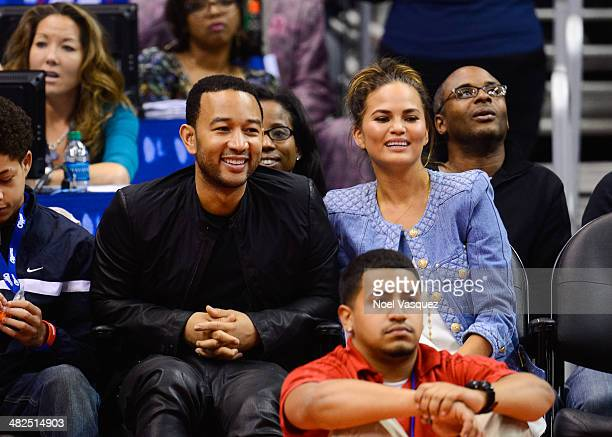 John Legend and Christine Teigen attend a basketball game between the Dallas Mavericks and the Los Angeles Clippers at Staples Center on April 3,...