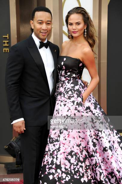 John Legend and Christine Teigen attend the Oscars held at Hollywood Highland Center on March 2 2014 in Hollywood California