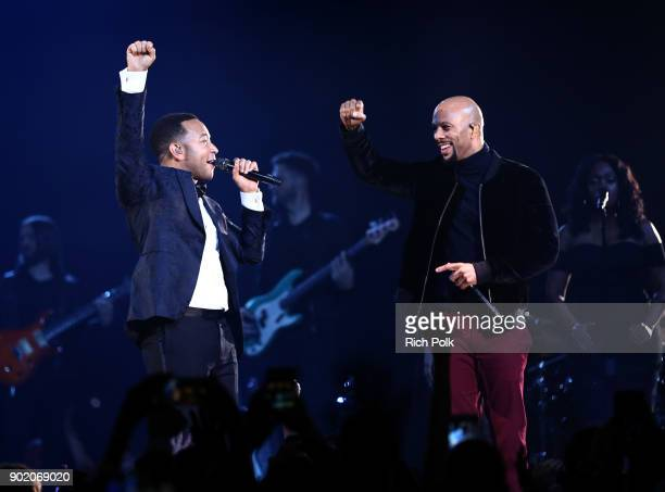 John Legend and Common perform onstage during The Art of Elysium presents John Legend's HEAVEN at Barker Hangar on January 6 2018 in Santa Monica...