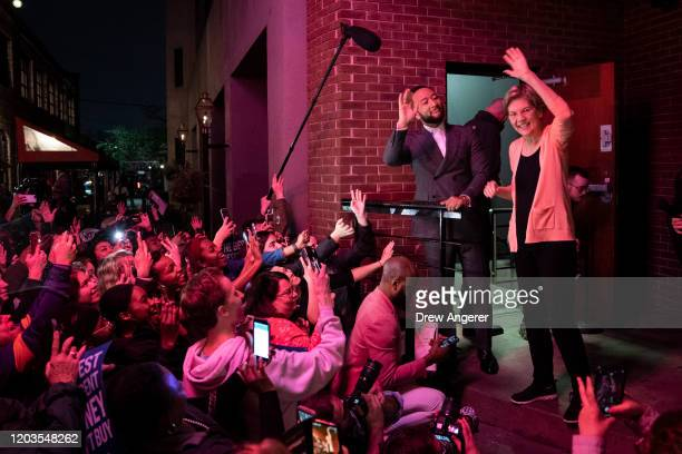 John Legend and Democratic presidential candidate Sen Elizabeth Warren greet an overflow crowd outside of the Charleston Music Hall before Legend and...