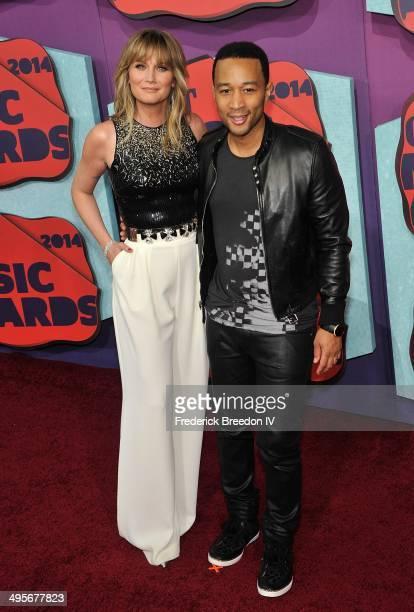 John Legend and Jennifer Nettles arrive at the 2014 CMT Music awards at the Bridgestone Arena on June 4 2014 in Nashville Tennessee
