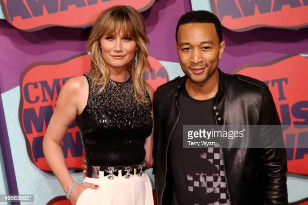 John Legend and Jennifer Nettles attend the 2014 CMT Music awards at the Bridgestone Arena on June 4 2014 in Nashville Tennessee