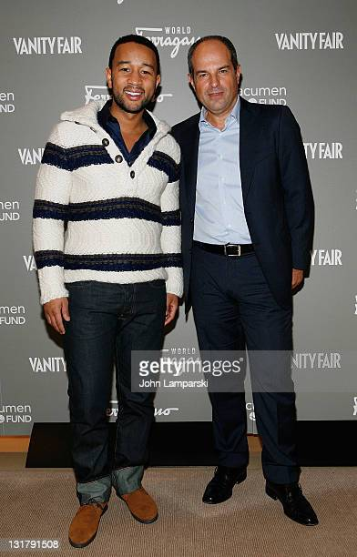 John Legend and Massimo Ferragamo attend the Ferragamo WORLD launch party at Salvatore Ferragamo on October 21, 2010 in New York City.
