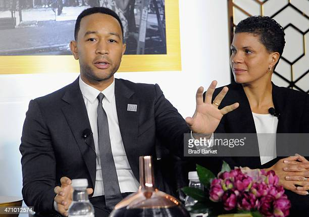 John Legend and Michelle Alexander speak onstage at An Evening With John Legend hosted by POLITICO to kickoff White House Correspondents' weekend at...