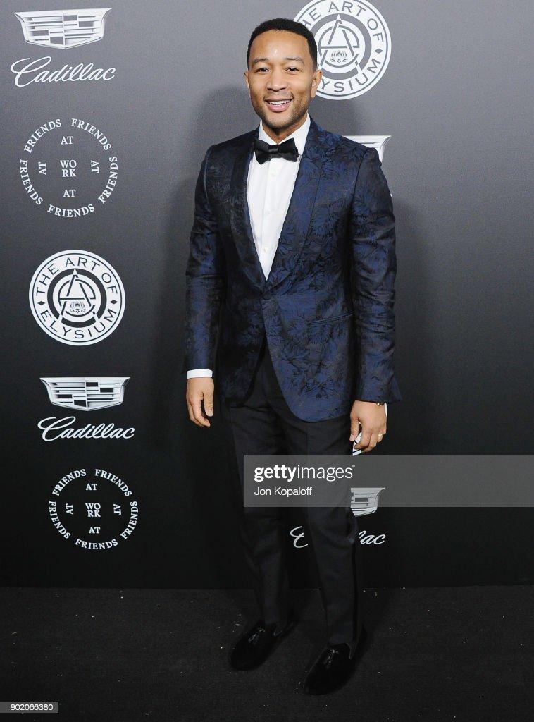John Legend attends The Art Of Elysium's 11th Annual Celebration - Heaven at Barker Hangar on January 6, 2018 in Santa Monica, California.