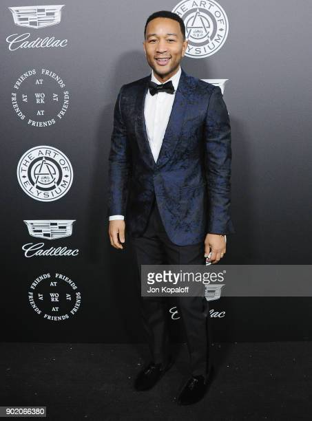 John Legend attends The Art Of Elysium's 11th Annual Celebration Heaven at Barker Hangar on January 6 2018 in Santa Monica California