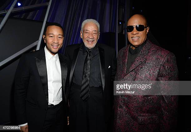 John Legend Bill Withers and Stevie Wonder attend the 30th Annual Rock And Roll Hall Of Fame Induction Ceremony at Public Hall on April 18 2015 in...