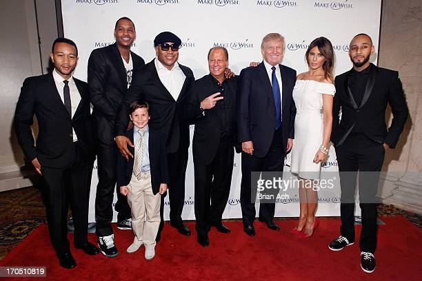 """John Legend, Carmelo Anthony, LL Cool J, Stewart Rahr, Donald Trump, Melania Trump and Swizz Beatz pose with a Wish Kid at """"An Evening of Wishes"""",..."""