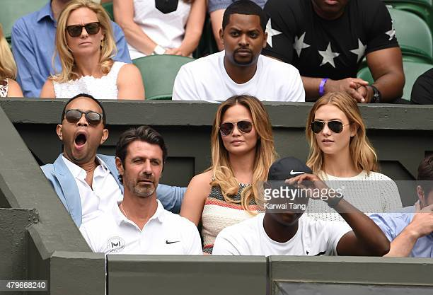 John Legend Chrissy Teigen and Karlie Kloss attend day seven of the Wimbledon Tennis Championships at Wimbledon on July 6 2015 in London England